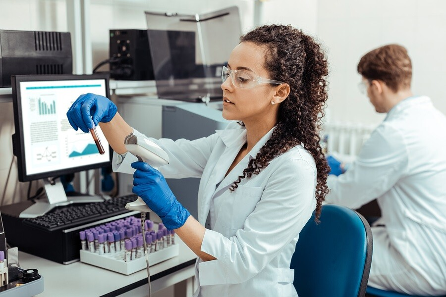 Researcher scanning barcode into LIMS