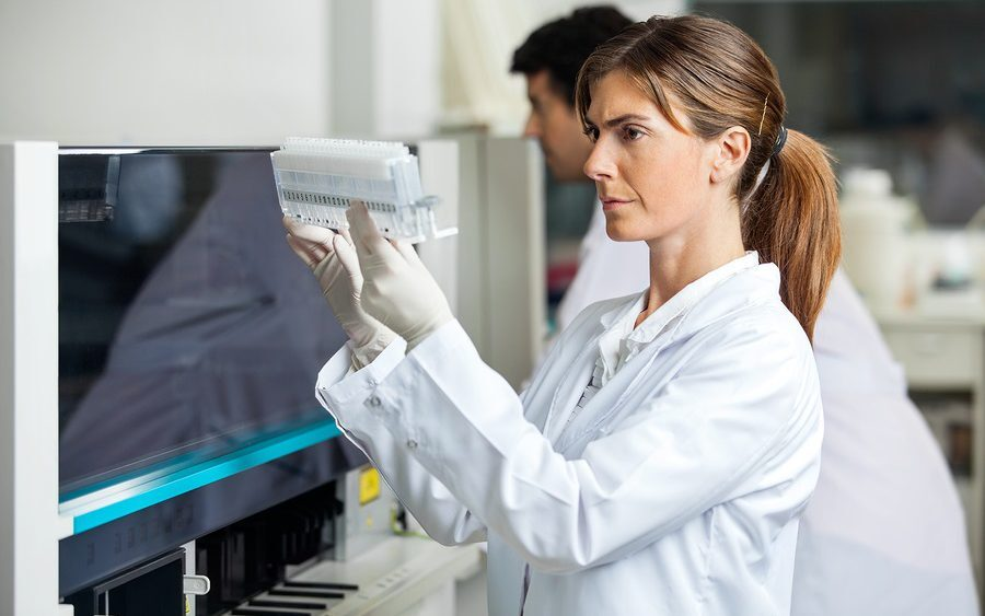 Researcher analysing samples in laboratory