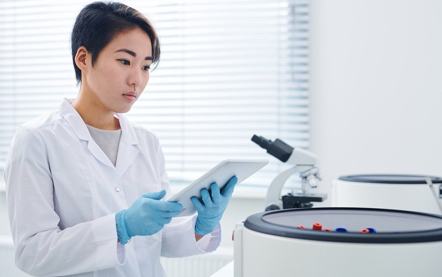 Researcher carrying out internal lab audit